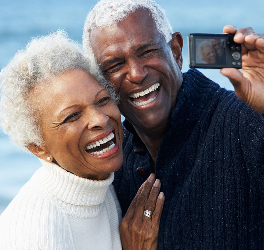 Older man and woman taking a selfie