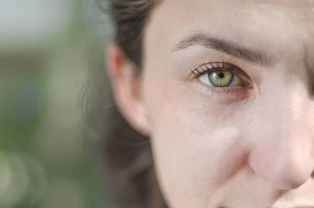 Closeup of a woman's green eye
