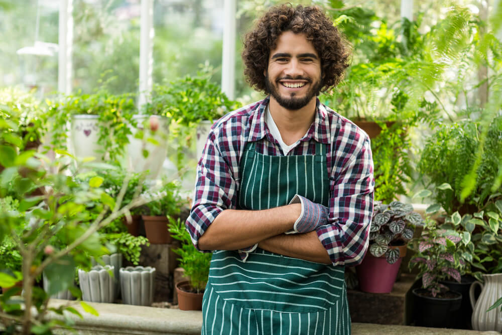 young man in greenhouse